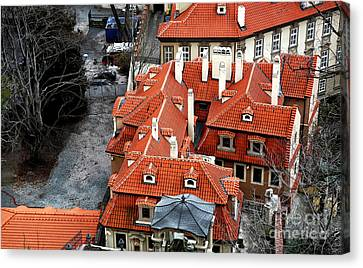Roofs In Prague Canvas Print by John Rizzuto