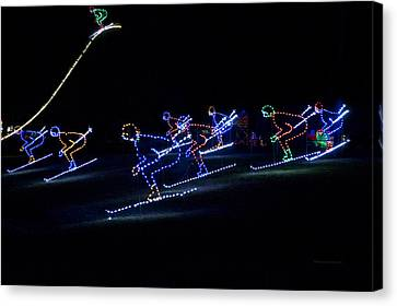 Rope Light Art Skiers Canvas Print by Thomas Woolworth