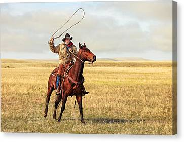 Roping On The High Plains Canvas Print by Todd Klassy