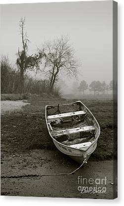 Row Boat And Low Tide Canvas Print by Dave Gordon