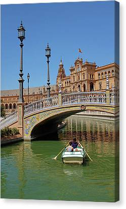Row Boating In Seville Canvas Print by Carlos Caetano