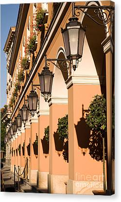 Row Of Lamps On Columns Of Building  Canvas Print