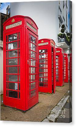 Row Of Phone Booths Canvas Print by Inge Johnsson