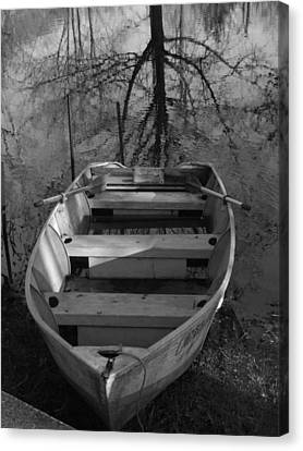 Rowboat And Tree Canvas Print by Michael L Kimble