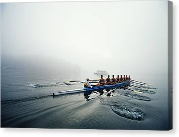Rowing Team On Lake In Early Morning Fog Canvas Print by Nick Wilson