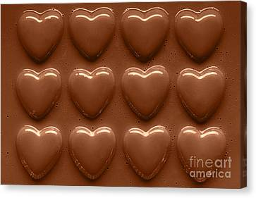 Swirling Desires Canvas Print - Rows Of Chocolate Hearts  by Richard Thomas