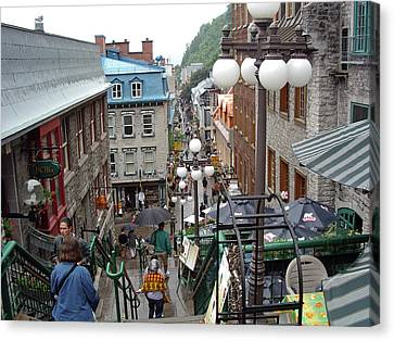 Canvas Print featuring the photograph rue du Petit Champlain by John Schneider