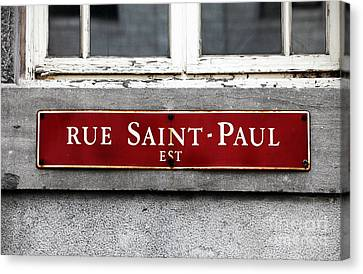 Rue Saint-paul Canvas Print by John Rizzuto