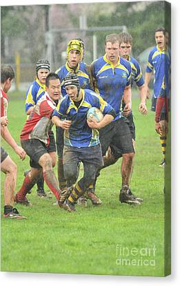 Rugby In The Mud Canvas Print by Rod Wiens
