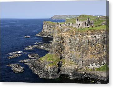 Ruins Of Dunluce Castle On The Sea Cliffs Of Northern Ireland Canvas Print by Pierre Leclerc Photography