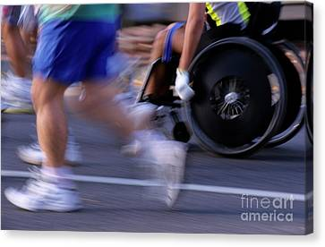 Runners And Disabled People In Wheelchairs Racing Together Canvas Print by Sami Sarkis