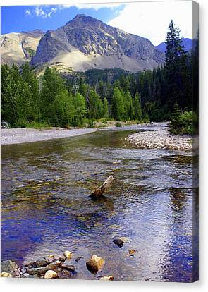 Running Eagle Creek Glacier National Park Canvas Print by Marty Koch