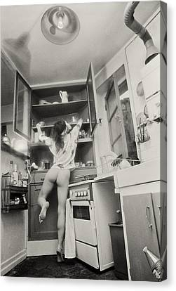 Running Through The Kitchen Canvas Print by Philippe Taka