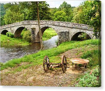 Rural France With Old Stone Arched Bridge Canvas Print by Menega Sabidussi