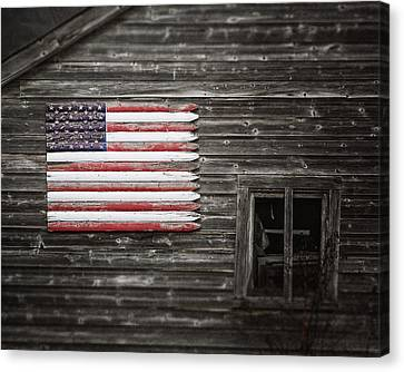 Rustic American Flag On A Weathered Grey Barn Canvas Print