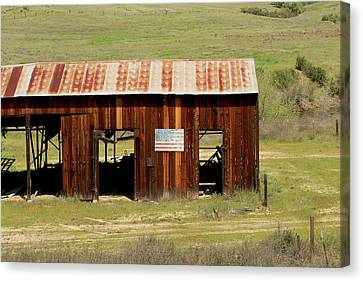Canvas Print featuring the photograph Rustic Barn With Flag by Art Block Collections