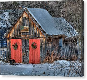 Rustic Barn With Flag In Snow Canvas Print by Joann Vitali