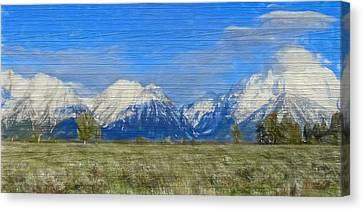 Rustic Grand Teton Range On Wood Canvas Print by Dan Sproul