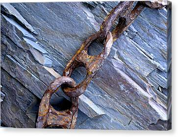 Rusty Chain On The Rocks Canvas Print by Tom  Wray