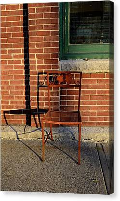 Canvas Print featuring the photograph Rusty Chair At Sunset by Corinne Rhode