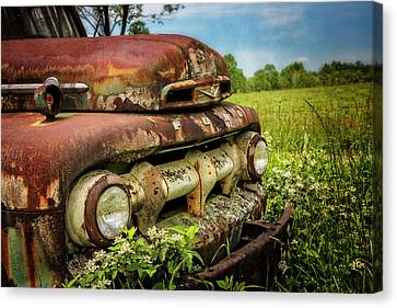 Rusty Ford In The Country Canvas Print by Debra and Dave Vanderlaan