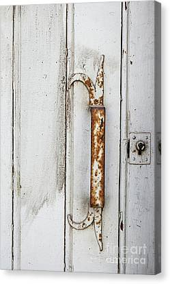 Rusty Handle On White Door Canvas Print