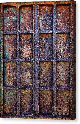 Rusty Iron Window Canvas Print by Carlos Caetano