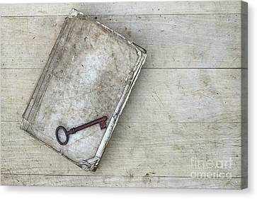 Canvas Print featuring the photograph Rusty Key On The Old Tattered Book by Michal Boubin