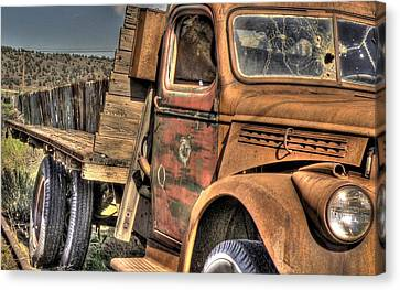 Rusty Old Truck Canvas Print by Peter Schumacher