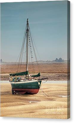 Sail Boat Stranded At Low Tide On Sand Canvas Print