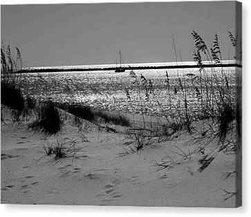 Sailboat Between Sand Dunes Canvas Print by Floyd Smith