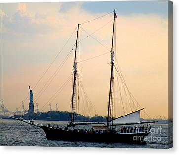 Sailing Past Miss Liberty Canvas Print by Randall Weidner