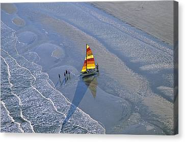 Sailors Take To The Ocean While Canvas Print by Kenneth Garrett