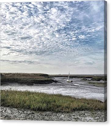 Salt Marsh And Creek, Brancaster Canvas Print by John Edwards