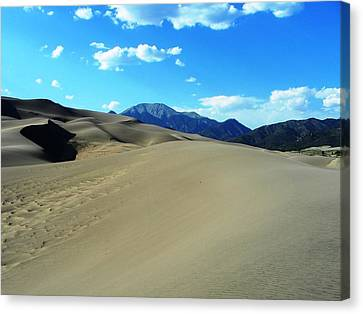 Sand And Mountains Canvas Print by Peter  McIntosh