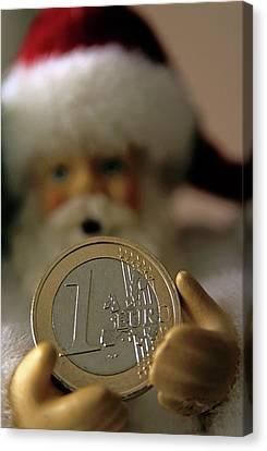 Santa Claus Doll Holding Out A Euro Coin Canvas Print