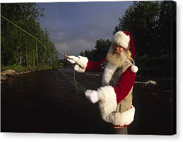 Santa Claus Fly Fishing Canvas Print by Michael Melford