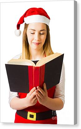 Santa Helper Reading Christmas Story Book Canvas Print by Jorgo Photography - Wall Art Gallery