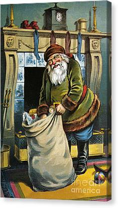 Santa Unpacks His Bag Of Toys On Christmas Eve Canvas Print by William Roger Snow