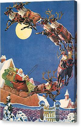 Santa's Sleigh And Reindeer Flying In The Night Sky On Christmas Eve Canvas Print