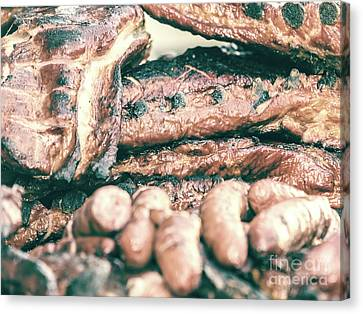 Sausages And Steaks On Barbecue Grill Canvas Print by Radu Bercan