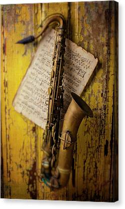 Saxophone Hanging On Old Wall Canvas Print by Garry Gay