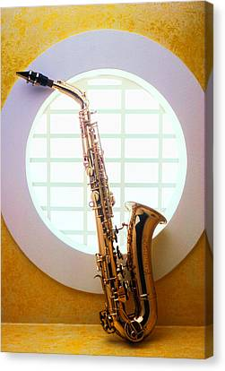 Saxophone In Round Window Canvas Print by Garry Gay