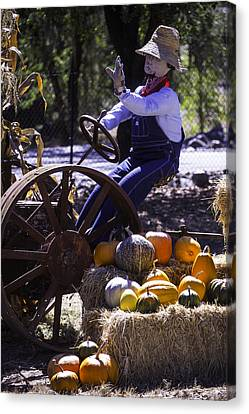 Overalls Canvas Print - Scarecrow On Tractor by Garry Gay
