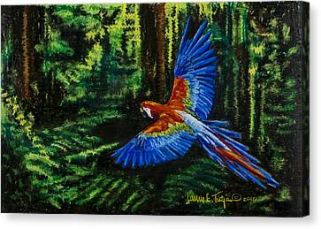 Scarlet Macaw In The Forest Canvas Print by Laurie Tietjen