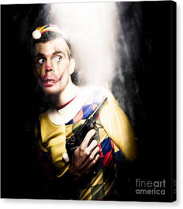 Scary Clown Standing In Shadows With Smoking Gun Canvas Print by Jorgo Photography - Wall Art Gallery