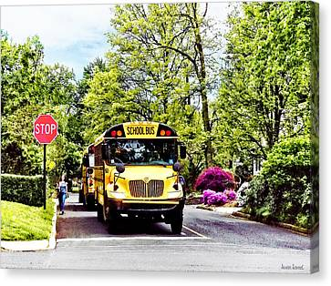 School Buses At Stop Sign In Spring Canvas Print by Susan Savad