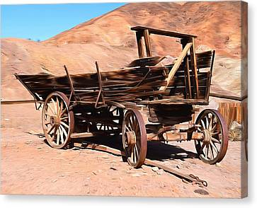 Old Wagon Wheel Canvas Print - Scorched And Abandoned At Calico Ghost Town by Barbara Snyder