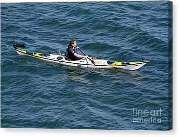 Sea Kayak Man Kayaking Off The Coast Of Dorset England Uk Canvas Print by Andy Smy