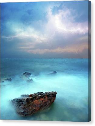 Sea Sky And Stone Canvas Print by Michael Greenaway